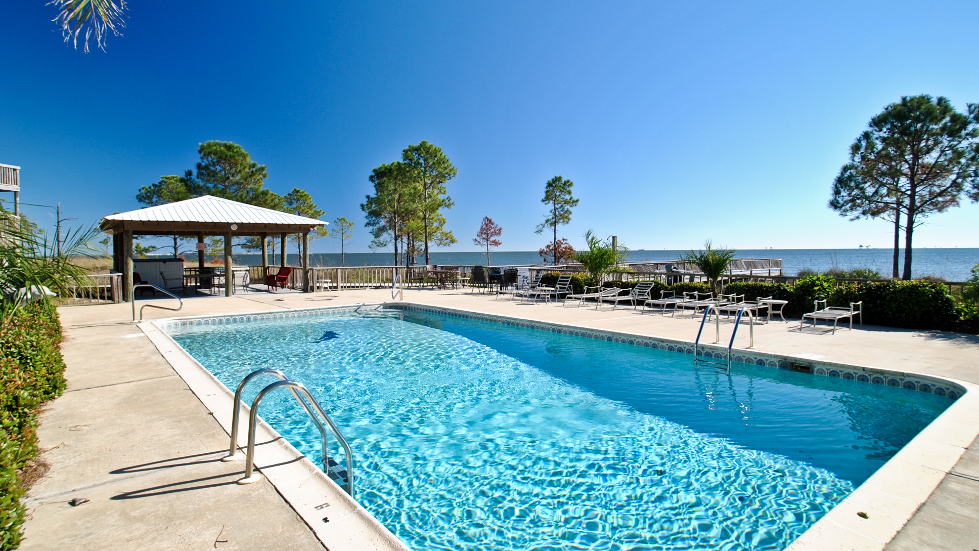 Gulf-side swimming pool at Sandcastle Condominiums, a vacation rental beach condo on Dauphin Island Alabama managed by Dauphin Island Beach Rentals