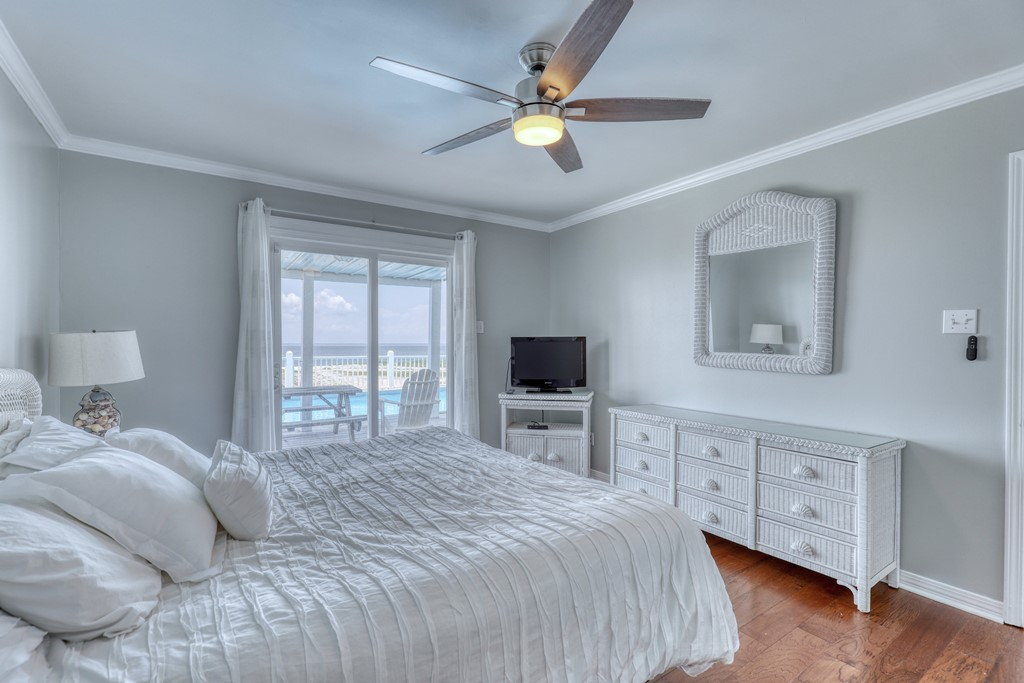 Master Bedroom with walkout Balcony over pool and bay view