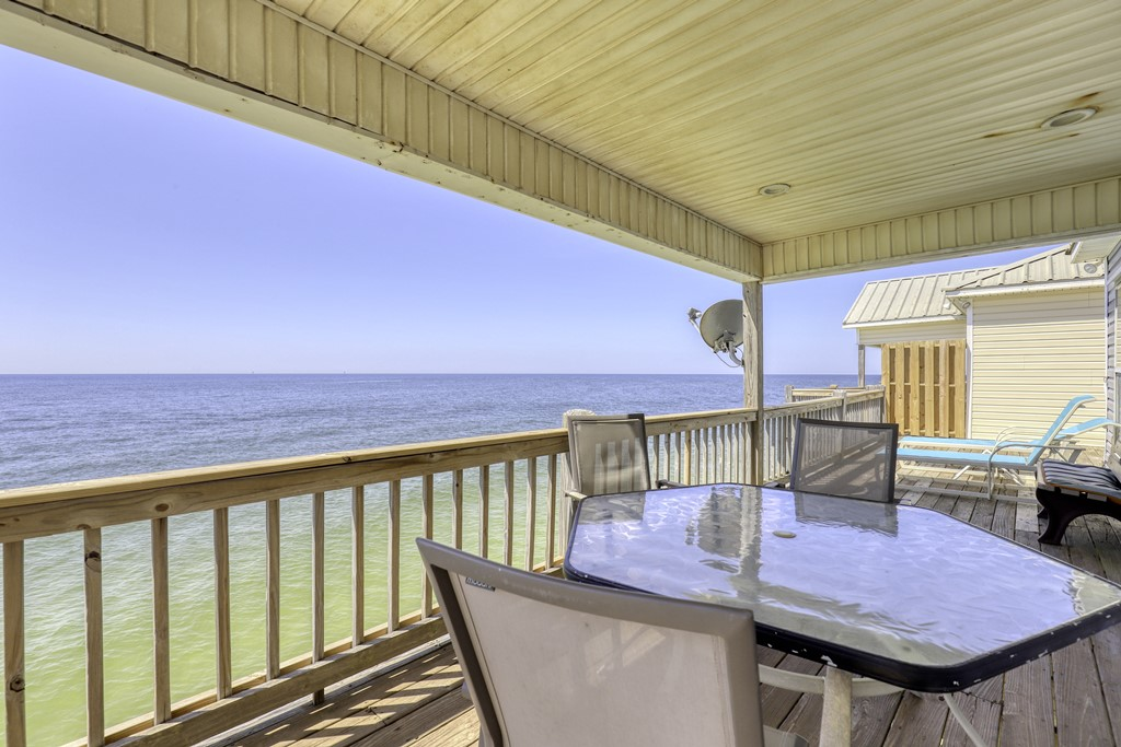Dine on the deck overlooking gulf