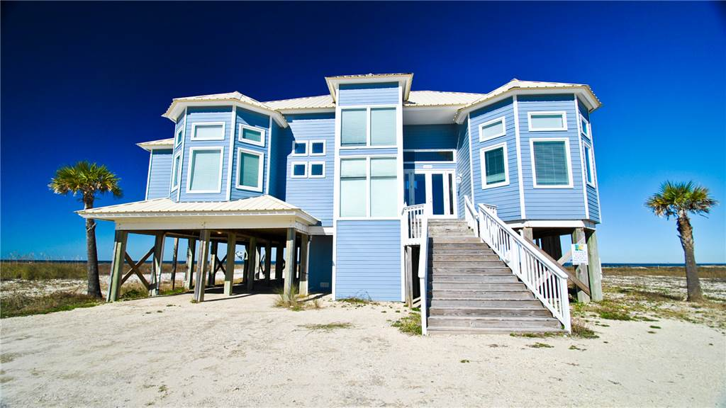 Luxury Waterfront Home with a Private Pool and Hot Tub overlooking a private bayfront sandy beach on the north shore of Dauphin Island.