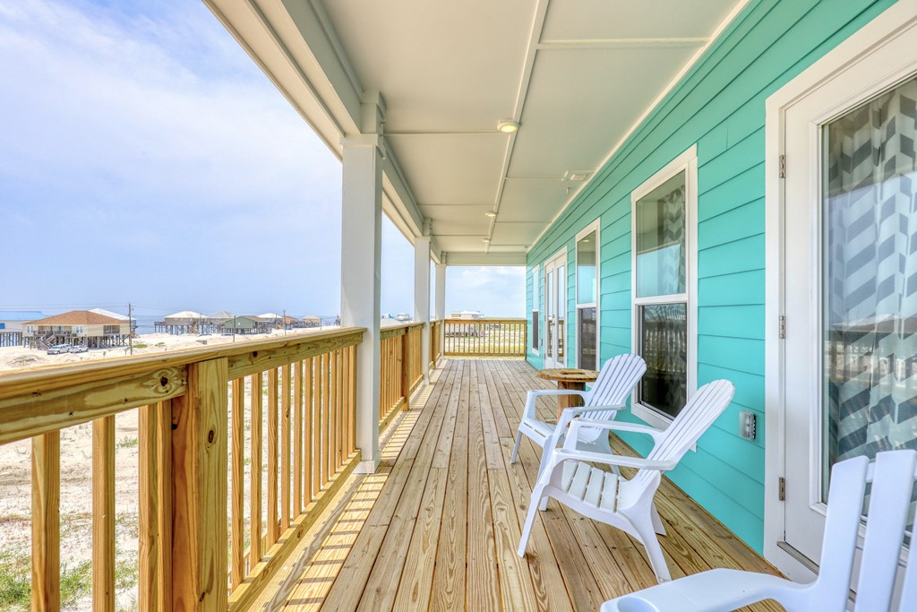 Upper front porch looking at gulf